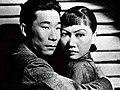 Daughter of Shanghai (1937) - Anna May Wong and Philip Ahn.jpg