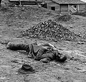 Thomas C. Roche - One of Roche's Civil War photographs, showing a dead Confederate soldier at Fort Mahone, Petersburg, Virginia April,1865.