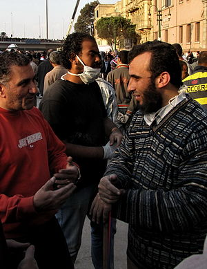 English: A Copt (left) and a Salafi (right) de...