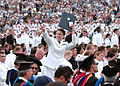 Defense.gov News Photo 100528-N-3857R-367 - A U.S. Naval Academy midshipman celebrates after receiving her diploma during the academy s 2010 graduation and commissioning ceremony at.jpg