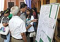Delegatesmedia people going through the Screening Schedule of the 45th International Film Festival of India (IFFI-2014), in Panaji, Goa on November 19, 2014.jpg