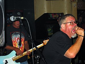 Dicks (band) - Dicks performing in Austin, Texas in 2005; pictured left to right: Buxf Parrott and Gary Floyd