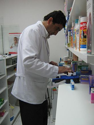 Drug packaging - Preparing consumer packaging of prescription drugs at pharmacy