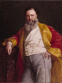 エドワード・ハリソン・メイの描いたアイザック・メリット・シンガーの肖像画です。赤色のサテン風生地に黄色のパイピングを施したローブを着ています。
