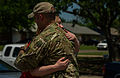 Elise Hopkins, left, embraces U.S. Air Force Capt. Van Blaylock, a joint terminal attack controller assigned to the 146th Air Support Operations Squadron, Oklahoma Air National Guard, in Moore, Okla., May 22 130522-F-RH756-287.jpg