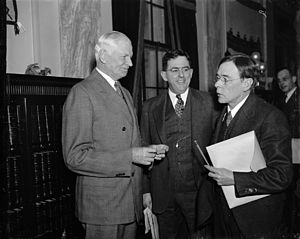 "Agricultural Adjustment Act - Senator Elmer Thomas is seen here on the left.  He is standing with Claude M. Hurst and John Collier, members of the Senate Indian Affairs Committee, and unassociated (directly) with the ""Thomas Amendment."""