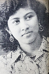 A black and white portrait of a young woman.