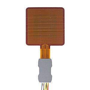 The image shows the FHF02SC, a thin self-calibrating heat flux sensor. The sensor area is a rounded square, with a metal attachment coming of the bottom housing the cable. On the square are traces of the heater running left and right.