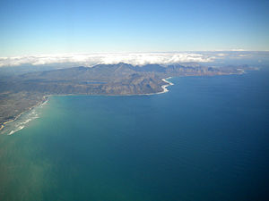 False Bay - Eastern False Bay coast aerial view looking somewhat south of east: Gordon's Bay (left) to Cape Hangklip (right)