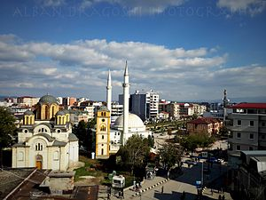 Demographics of Kosovo - Serbian Orthodox Church (left) and Sunni Muslim Mosque (right) in Ferizaj.
