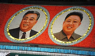 Kim Jong-un - Portraits of Kim Jong-un's father and grandfather (Arirang Festival mass games in Pyongyang)