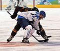 Finland vs Germany faceoff Olympics 2010 (cropped1).jpg