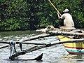 Fisherman on Skiff - Negombo - Sri Lanka (14050216907).jpg