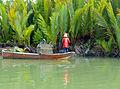 Fishermen picking up fish traps (15819295766).jpg