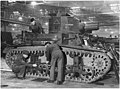 Fitters are at work assembling an American light tank which has just arrived at an English ordnance depot from the US... - NARA - 196324.jpg