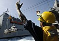 Flickr - Official U.S. Navy Imagery - A Sailor guides pallets during an underway replenishment..jpg