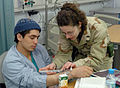 Flushing an IV line at Craig Joint Theater Hospital, Bagram.jpg