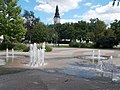 Fountain and Reformed church tower, Kossuth Square, Kecskemét 2016 Hungary.jpg