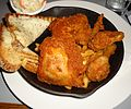 Fried chicken served at a restaurant with french fries.jpg