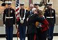 Gen. Robert Magnus hugs Deb Dunham.jpg