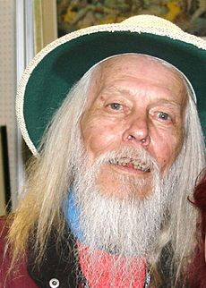 A man with a white beard and a hat.