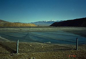Netted solution pond next to cyanide heap leac...