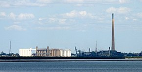 Grain silos, smelter and smoke stack from across the river, Port Pirie, South Australia.jpg