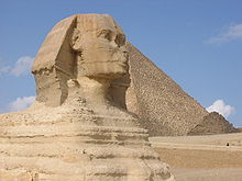 alpha phi alpha chose to use egyptian symbolism more representative of the members african heritage the great sphinx and great pyramids of giza are