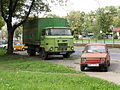 Green IFA L60 truck and red Polski Fiat 126p FL in Nowa Huta district in Kraków.jpg