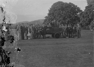 Group of people on a golf course with green keeping equipment
