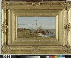 Een palissade met visnetten bij een meer