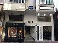 HK Central 擺花街 30 Lyndhurst Terrace sidewalk shops n walk-up building stairs Oct-2011.jpg