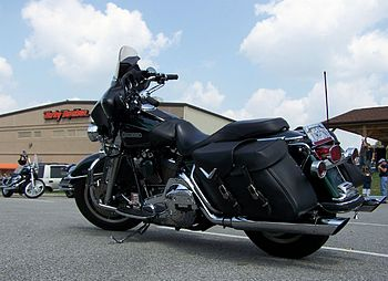 A black Harley-Davidson motorcycle with saddlebags