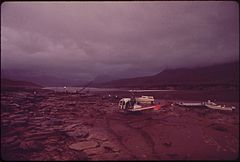 Helicopters Bringing Relief Work Crews Land in Rain at Site of Oil Spill Clean - Up Operations in Monument Valley, Utah, on the Banks of the San Juan River, 10-1972 (3814971080).jpg