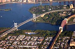 Aerial view of the Triborough Bridge (left) and the Hell Gate Bridge (right) spanning Astoria Park and the Astoria Pool