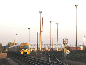 Hoo Junction - Up yard of Hoo Junction with a Networker train on the main line