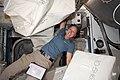 ISS-64 Shannon Walker unpacks spacewalk hardware inside the Quest airlock.jpg