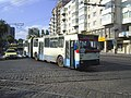 Iasi DAC articulated trolleybus 406 southbound on Strada Sararie at Strada Cuza Voda, August 2005.jpg