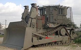 Armored bulldozer - IDF Caterpillar D9 armored bulldozer parking near army base.