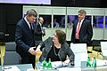 Informal meeting of ministers responsible for development (FAC). Round table Andrus Ansip and Maria Karnoutsou (36351259633).jpg