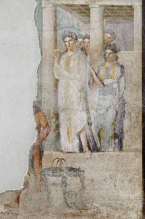 Pylades - Iphigenia as a priestess of Artemis in Tauris sets out to greet prisoners, amongst which are her brother Orestes and his friend Pylades; a Roman fresco from Pompeii, 1st century AD