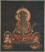 Frontal view of a seated figure with halo flanked by two small figures.