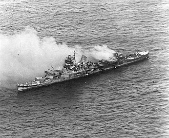 Japanese cruiser Mikuma - Mikuma burning after being bombed by American carrier planes, just before sinking. Note her completely destroyed midsection.