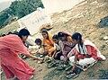 Kuki Taruna Kumari feeding the children of Nauwa village at the Chatur Sadhana Sthal.jpg