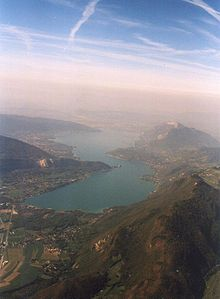 Aerial view of narrow lake between mountains
