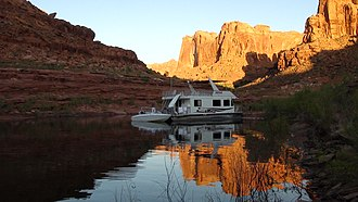 Glen Canyon National Recreation Area - Houseboat and powerboat in Knowles Canyon on Lake Powell, Glen Canyon National Recreation Area, Utah
