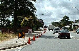 Australian Road Rules - Cone taper for left lane closure in Western Australia showing small chevron (shifter), 40 km/h repeater, chevron and arrow-board