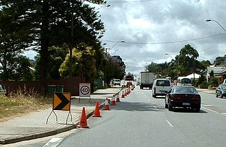 Australian Road Rules - Cone taper for left lane closure in Western Australia showing small chevron (shifter), 40 km/h repeater, chevron and arrow-board