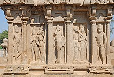 Figures carved into temple exterior