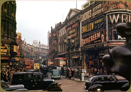 London , Piccadilly Circus looking up Shaftsbury Ave , circa 1949 ,Kodachrome by Chalmers Butterfield.jpg